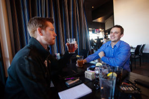Noble Hops: Explorer Photojournalist Randy Metcalf and Reporter Chris Flora enjoy a beer at Noble Hops.  - J.D. Fitzgerald/The Explorer