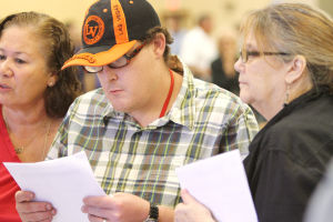 DREAM Job Fair: Seth Barkett and his mother Leda Barkett look over a list of job openings that Northwest Medical Center has to offer. Jobs range from an entry-level position to a professional-level position. - Randy Metcalf/The Explorer