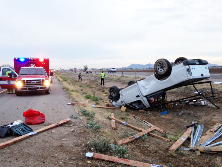 I-10 early morning rollover injures men