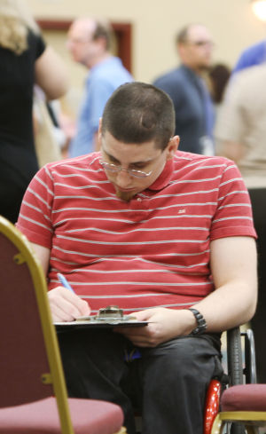 DREAM Job Fair: Robert Algeo fills out an application during the DREAM Job Fair at the Hotel Tucson City Center last week. - Randy Metcalf/The Explorer