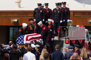 William Warneke Procession: The pallbearers pass down the casket as they prepare to take the body of Granite Mountain Hotshot William Warneke to the gravesite at Marana Mortuary and Cemetery. - J.D. Fitzgerald/The Explorer