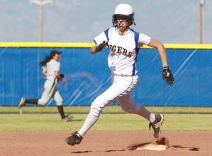 Marana Vs Desert Ridge Softball: Alex Gehr rounds second base to get to third.  - Randy Metcalf/The Explorer