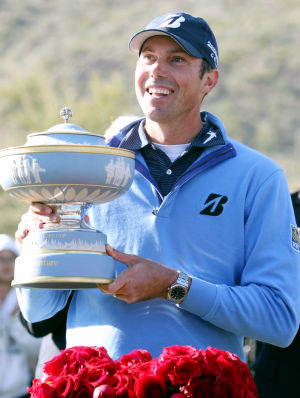 Final Round Of The Accenture Match Play Championship: Matt Kuchar of the U.S. holds up the Walter Hagan Cup after defeating defending champion Hunter Mahan on the 17th hole, beating him 2 and 1 on Sunday.  - Randy Metcalf/The Explorer
