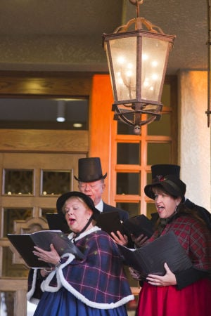 "Hilton El Conquistador Tree Lighting Ceremony: The Victorian Christmas carolers, ""What the Dickens"" sing as people make their way into the Hilton for the tree lighting ceremony. - Randy Metcalf/The Explorer"