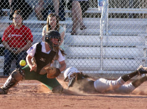 Canyon Del Oro Vs Mountain View Softball: Mountain View High School's Kayla Ugaitafa slides safely past Canyon Del Oro catcher Heather Knight during last week's game. The Dorados beat the Mountain Lions 23-11.  - Randy Metcalf/The Explorer