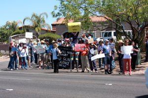Protesting U.S. Sen. Jeff Flake: Protesters lined up along Oracle Road last week outside of U.S. Sen. Jeff Flake's Tucson office.  - Randy Metcalf/The Explorer