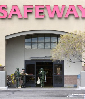 Robbery At The U.S. Bank Inside Safeway: Members of the Pima Regional Bomb Squad enter the Safeway at Thornydale and Linda Vista after a robot inspected a suspicious package left behind by a man who robbed the U.S. Bank within the store Monday.  - Randy Metcalf/The Explorer