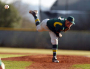 Canyon Del Oro Vs Ironwood Ridge Baseball: Canyon Del Oro pitcher Max Smith is out of focus as the pitch he delivered hurls towards home plate during last week's game against Ironwood Ridge High School. The Dorados won 9-4.  - Randy Metcalf/The Explorer