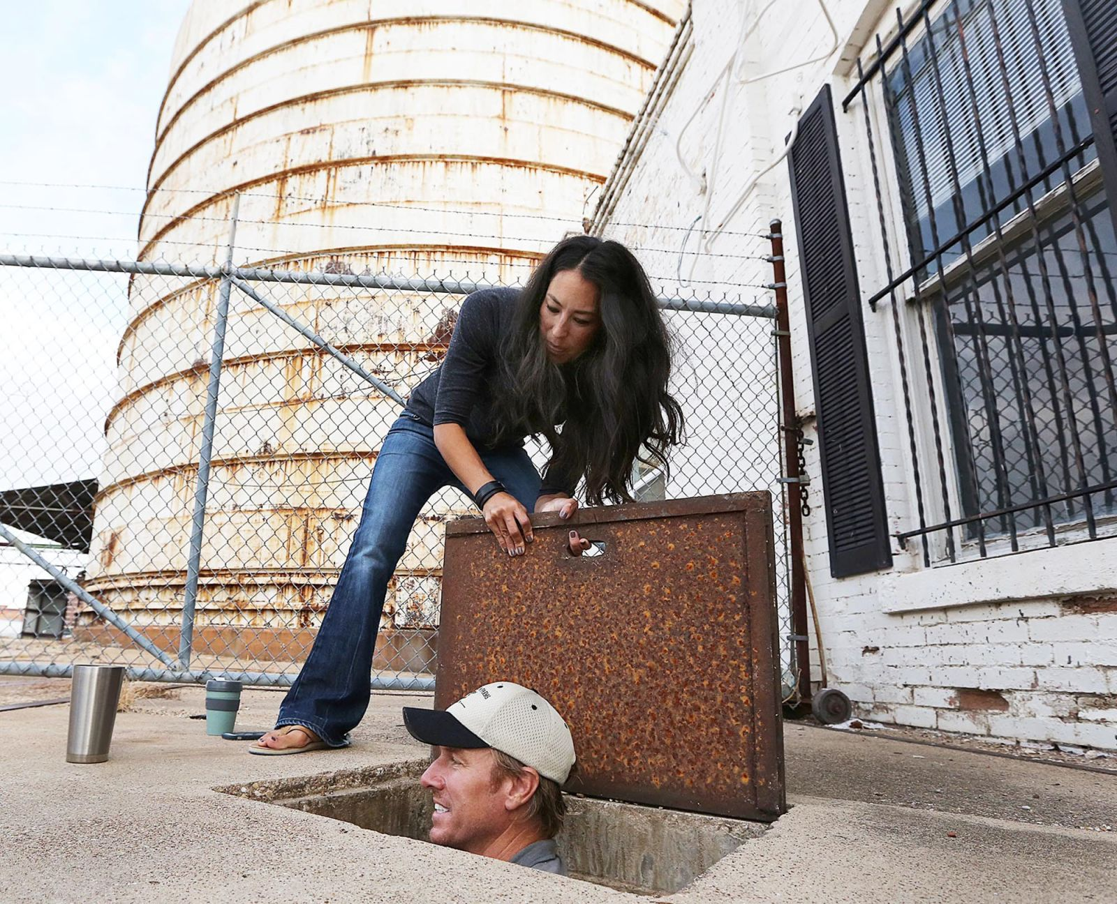 Hgtv stars get board s ok for century old cotton oil mill for Pictures of chip and joanna gaines