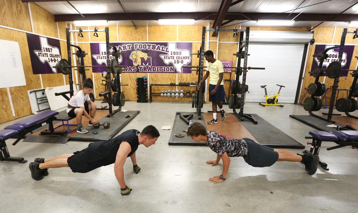 Logan Wehmeyer 16 Right Competes In A Pushup Compeion With Mart Police Chief Paul Cardenas Left At The High School Gym Wednesday