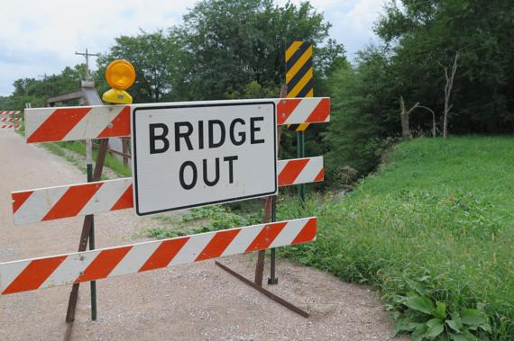 <p>A bridge out sign stands before a bridge outside Waverly. County Engineer Pam Dingman spoke with residents about the closures at a meeting last week. (Staff Photo by Peggy Brown)</p>
