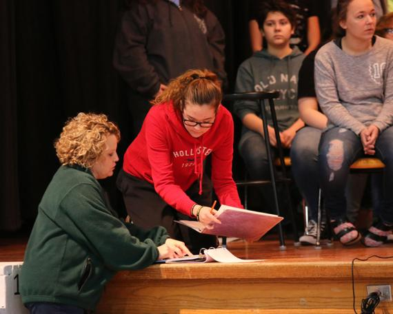 "<p>REHEARSAL: Ashland-Greenwood Vocal Music Director Amy Krance-Wendt works with Callie Johnson on her lines for ""High School Musical"" while other members of the cast look on during rehearsal last Friday. The musical will be performed on Friday and Saturday in the AGHS gym. (Staff Photo by Suzi Nelson)</p>"