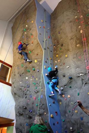 Eli Pfeiffer and Alexa Johannsen scale the climbing wall.