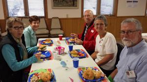 Faith in Action volunteers (from left) Sue Buche, Lorraine Enos and Lee Meyer of Hackensack, and Sue and Pat Bettenberg of Remer enjoy the spring training luncheon.