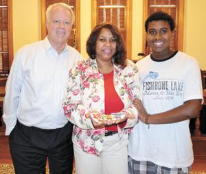 <p>From left is U.S. Rep. Paul Broun, R-Athens, who presented medals earned by Vincent Murphy to his widow, Martha Murphy, and son Kaylon Rodgers.</p>