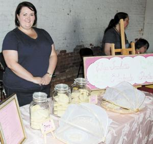 <p>Eliza Scarlett of Eliza Scarlett's Handmade Shortbread waits anxiously for customers Saturday morning at the Farmers market in downtown Monroe.</p>