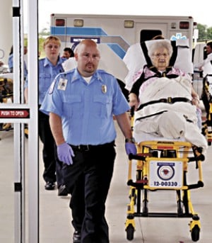 <p>From left, EMT Melissa Page and paramedic Ryan Harper transfer the final patient from Walton Regional, Euberta Malcom, into Clearview Regional Medical Center as the new hospital opens in Monroe Sunday, April 22, 2012.</p>