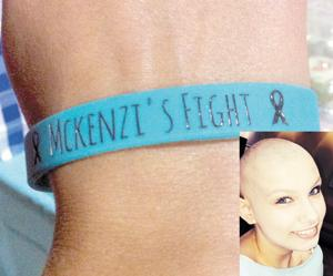<p>Wristbands were made bearing the slogan for McKenzi Middlebrooks' battle with cancer. Below, McKenzi continues her fight against the disease.</p>