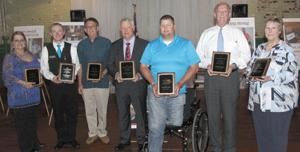 <p>Winners of awards during The Walton Tribune's 2016 Visions reception include, from left, Unsung Hero Kathy Sasser; Youth of the Year Lucas Udell; Unsung Hero William Carlan; Community Spirit Award winner Gary Hobbs; Unsung Hero Jason Shane; Ben Garrett, representing Employer of the Year Athens First Bank & Trust; and Unsung Hero Jackie Thomas.</p>