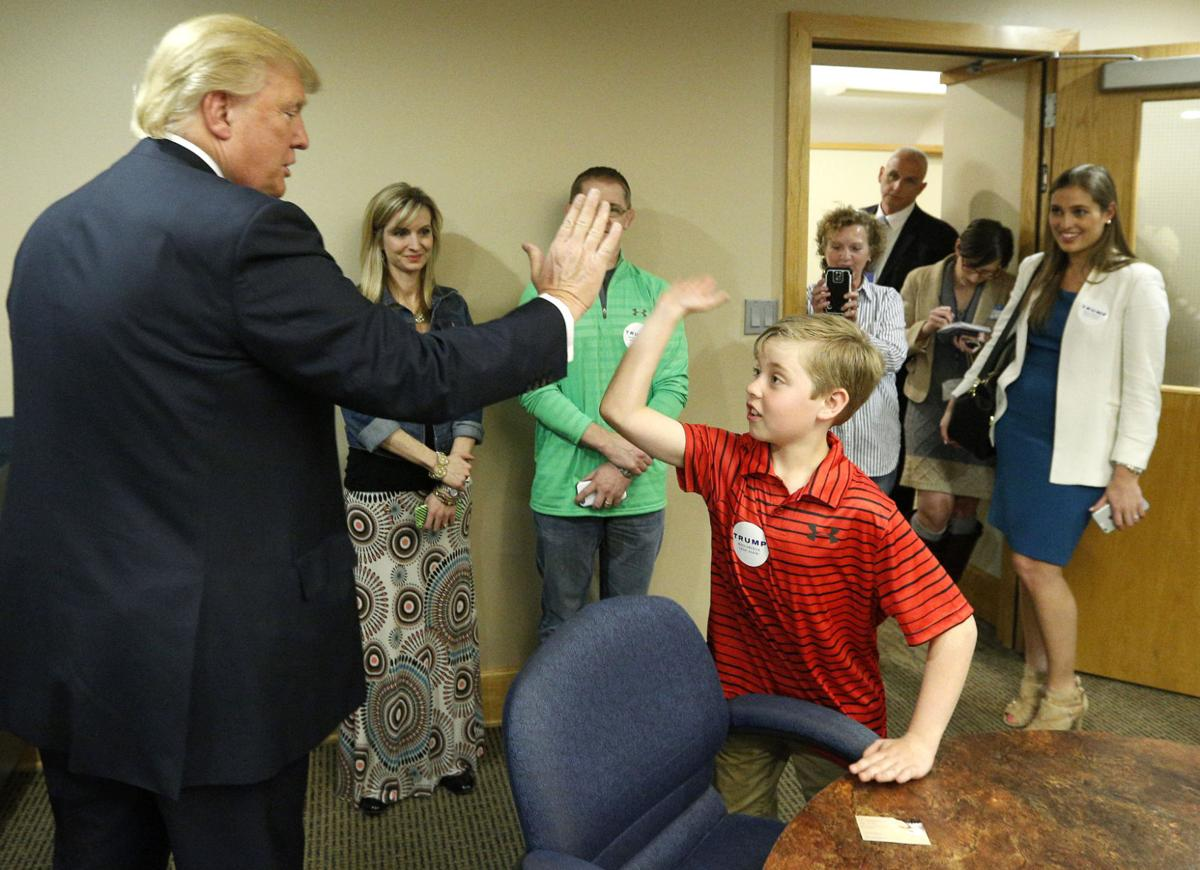 Donald Trump high fives Shay Doyle, 10, a big Trump fan after speaking ...