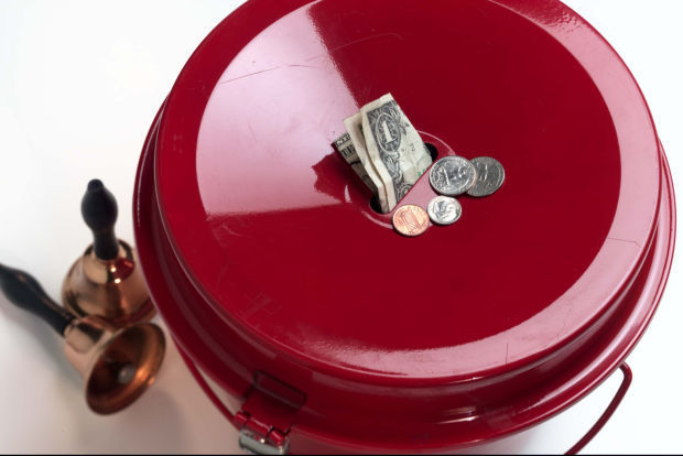 salvation army receives gold coin in kettle