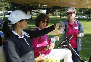Pink-clad golfers take a swing at cancer during annual tournament