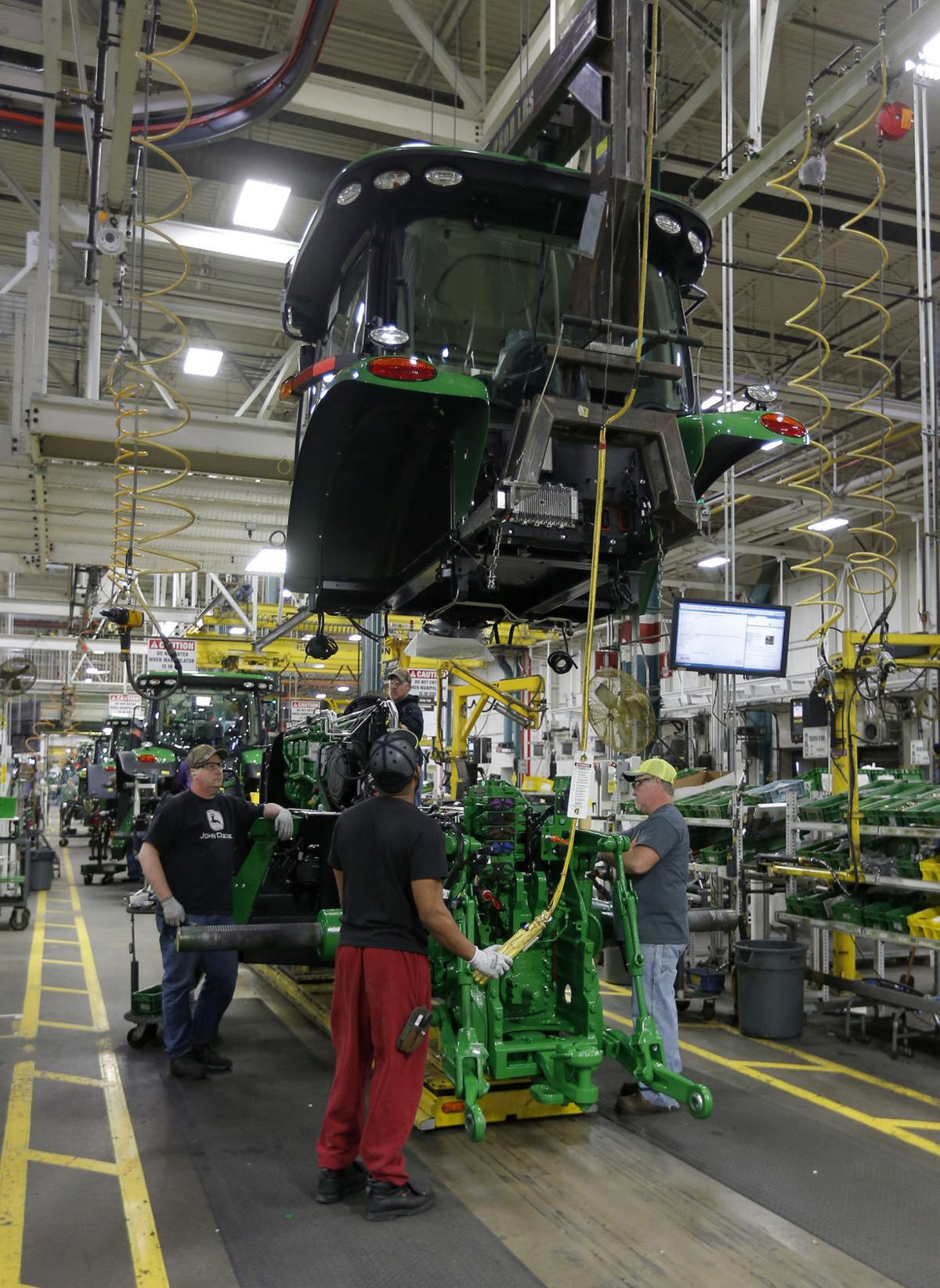 John Deere Assembly Line : Deere reinvests in waterloo readies for th party
