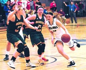 <p>Watertown senior guard Arianna Liddicoat drives against Beaver Dam's Afton Bartol (22) and Kaylee Miller (21) during a Wisconsin Little Ten Conference girls basketball game Tuesday at WHS. Beaver Dam won 61-48 to clinch the program's seventh consecutive league title.</p>