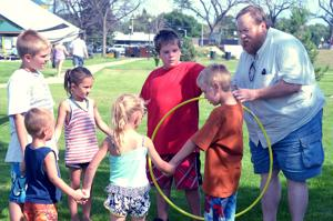 "<p class=""p1"">Charlee Guild • Williston Herald</p><p class=""p2""><span class=""s1""><strong>Eric Oines of Community Connections, showed Kellen Hodnefield, Kayson Hodnefield, Colton Hodnefield, Hailey, Kiera, and Tytan how to play a came where they had to move the hula hoop amongst themselves without breaking the circle.</strong></span></p>"