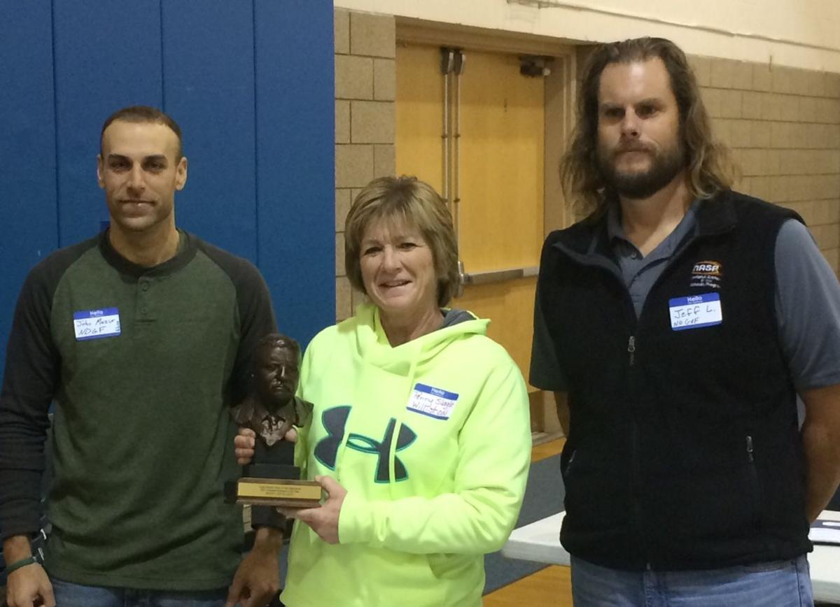 slagle earns award christen brothers honored community jon mazur left representing the north dakota game fish department joins jeff long of the ndgf to present williston high school teacher penny slagle