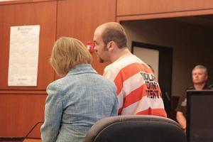 Spell pleads not guilty