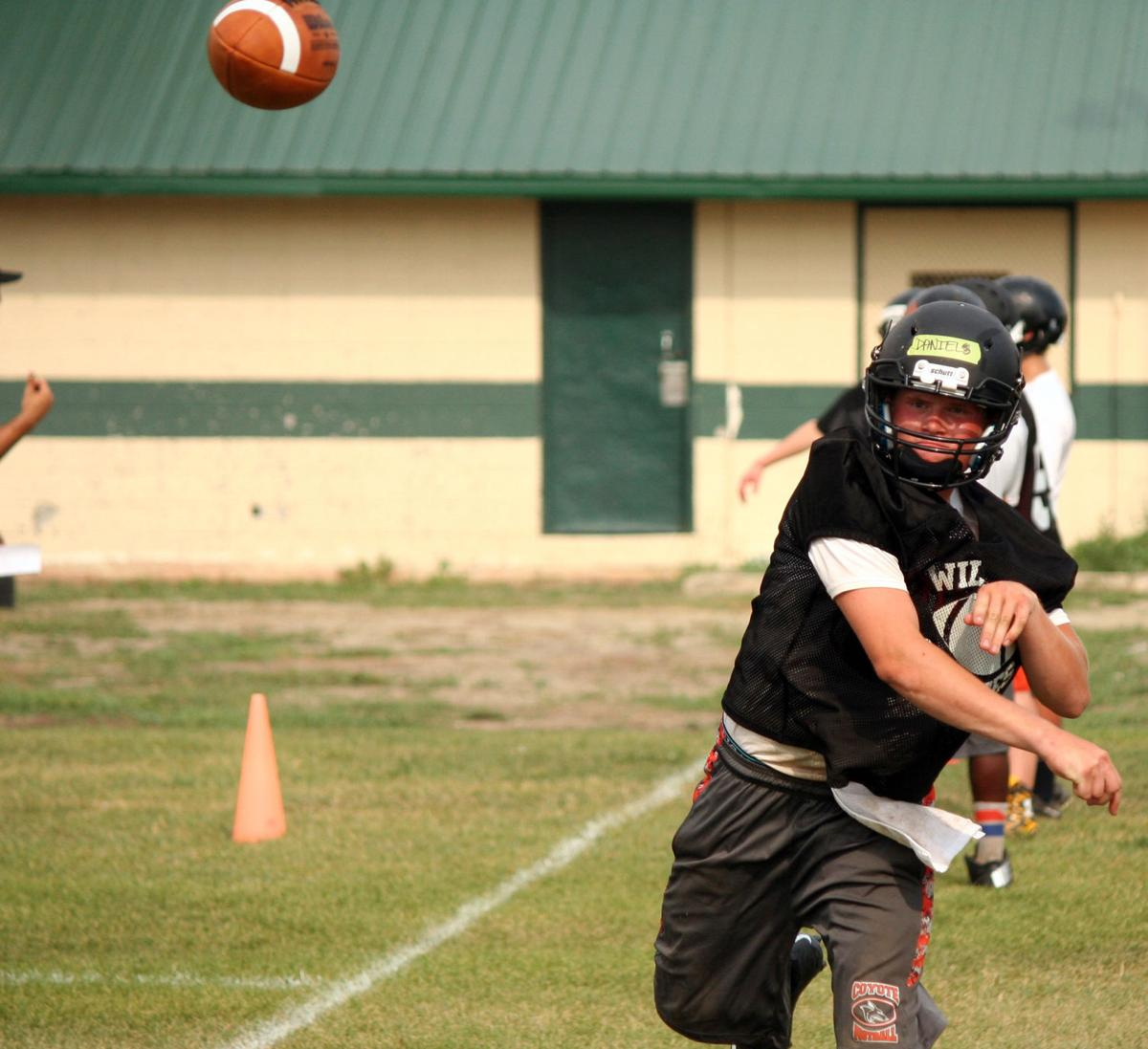 Ultimate Backyard Football : throws a pass into the flat during drills at Williston High football
