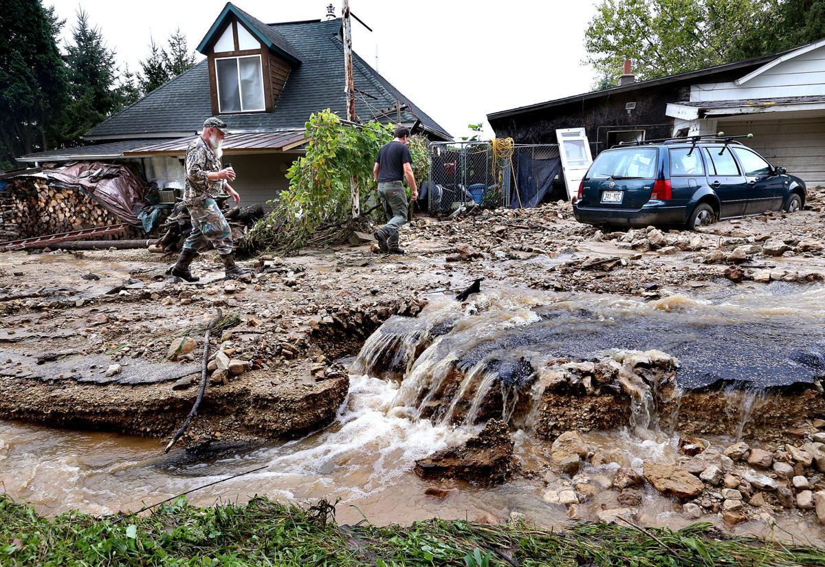 La Crosse News >> Deadly flooding causes area mudslides, closes roads | Local | winonadailynews.com