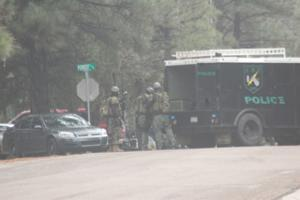 <p>Show Low Police and a Special Response Team respond to a residence on Settler's Lane off Cub Lake Road, near Walgreens, on Wednesday, Dec. 10, about a man with a gun who was upset over an undisclosed issue. The SRT team staged for entry, but the man reportedly voluntarily came out of the home he was in around 2 p.m. No other details are available at this time. The man's mother was also in the home at the time. Police took the man into custody. No injuries were reported, according to Show Low Cmdr. Brad Provost. The Navajo County Sheriff's Office is handling the investigation.</p>