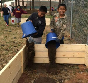 Many help with building STREAM garden at Cradleboard Elementary