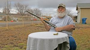 <p>Gun enthrusiast Mick Darling displays a model 1889 Remington 12 gauge, double barreled, outside hammer shotgun manufactured in 1903.</p>