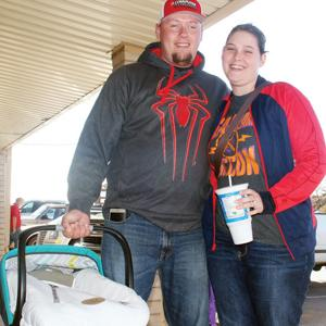 """<p>Proudly carrying 4-month-old Baby Declan out on errands with them, parents Stuart and Kirsty Hensleysaid, """"We are grateful for our family and a warm place to live to keep our baby healthy.""""</p>"""