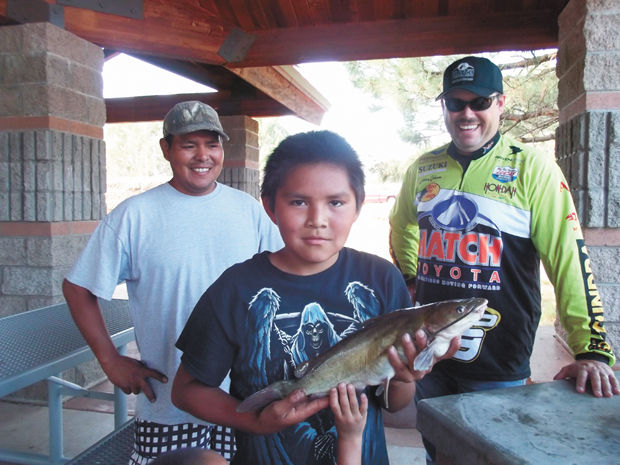 Reeling 39 em in at the annual kids fishing derby for Johnny johnson fishing