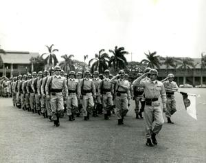 "<p class=""p1"">Jo Pretsch leads his men on the parade ground in Hawaii. The Pretsch family was stationed in Kailua, Kona, for five years. Pretsch had advanced to sergeant major rank.</p>"