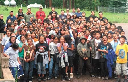 Apache youth camp in cool pines youth learn self esteem for Suttle fish farm