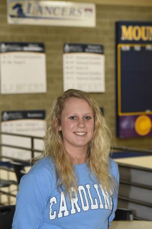 <p>Mount Marty College standout Alex Kneeland poses in Laddie E. Cimpl Arena on Monday. Kneeland leads the Lancers and ranks second in the Great Plains Athletic Conference in scoring this season.</p>