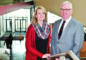 """<p dir=""""ltr"""" align=""""right"""">University of South Dakota student Stacy Starzl of Yankton – who also works full-time in the USD student services office -- and USD administrator Mike Card represent and work with the needs of non-traditional students on the Vermillion campus. They are shown in the Muenster University Center (MUC), which serves the more than 10,000 USD students.</p>"""