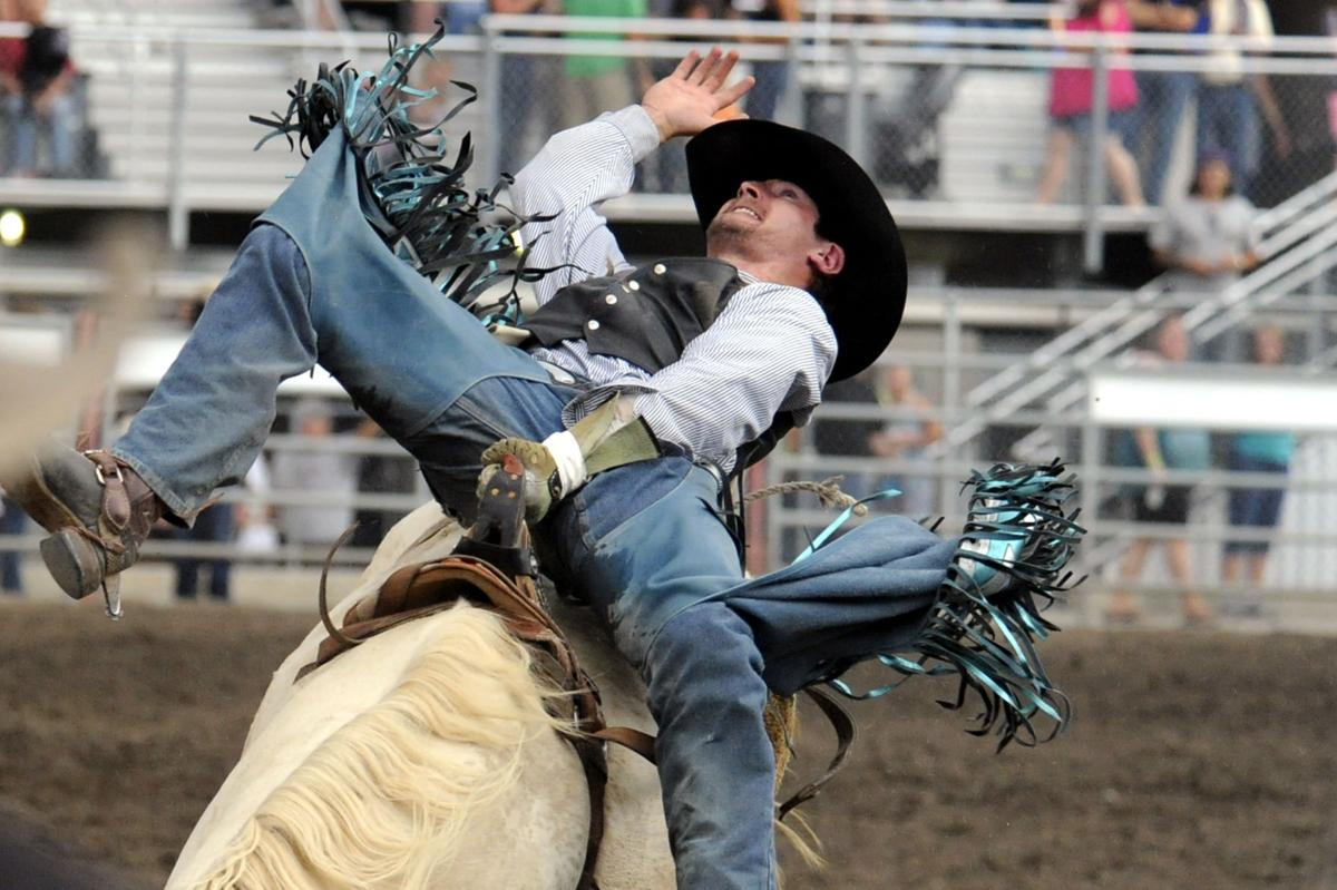 Texan brothers one-up each other with saddle bronc records