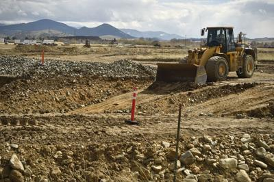 Contractors work to remove contaminated soil  from Dartman Field