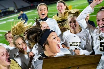 The Billings West girls celebrate