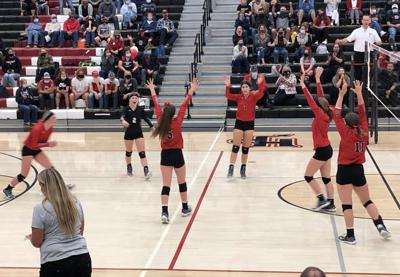 Huntley Project volleyball celebration