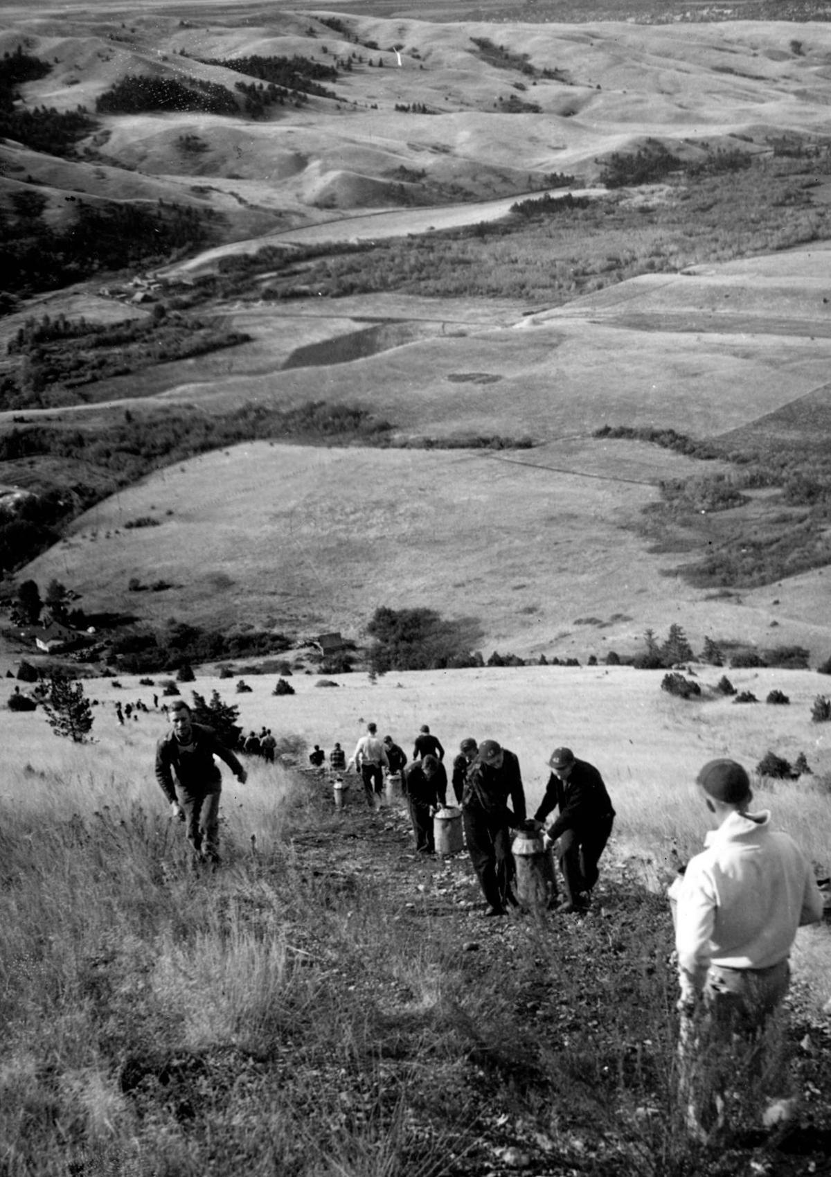 Students hauling whitewash up Mount Baldy