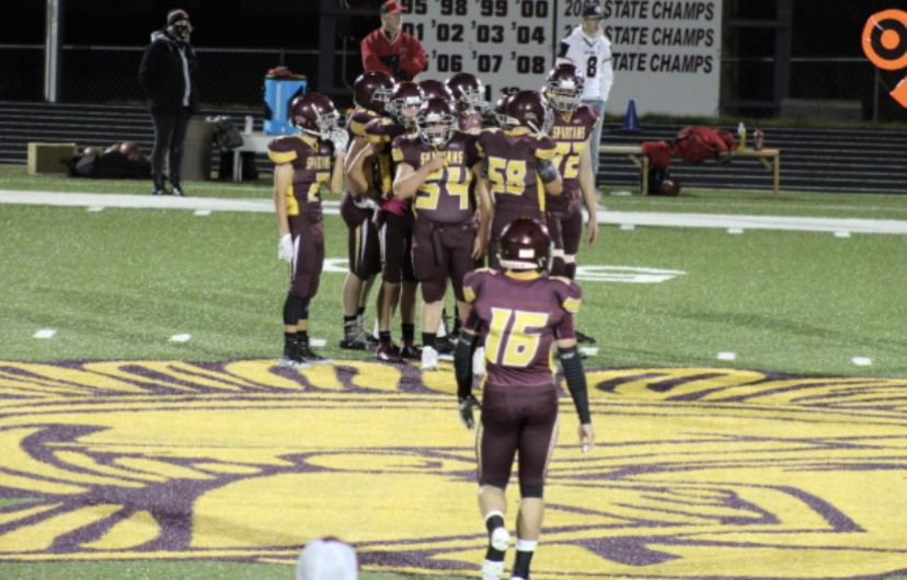 Baker football huddle