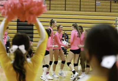 Helena Capital volleyball pink