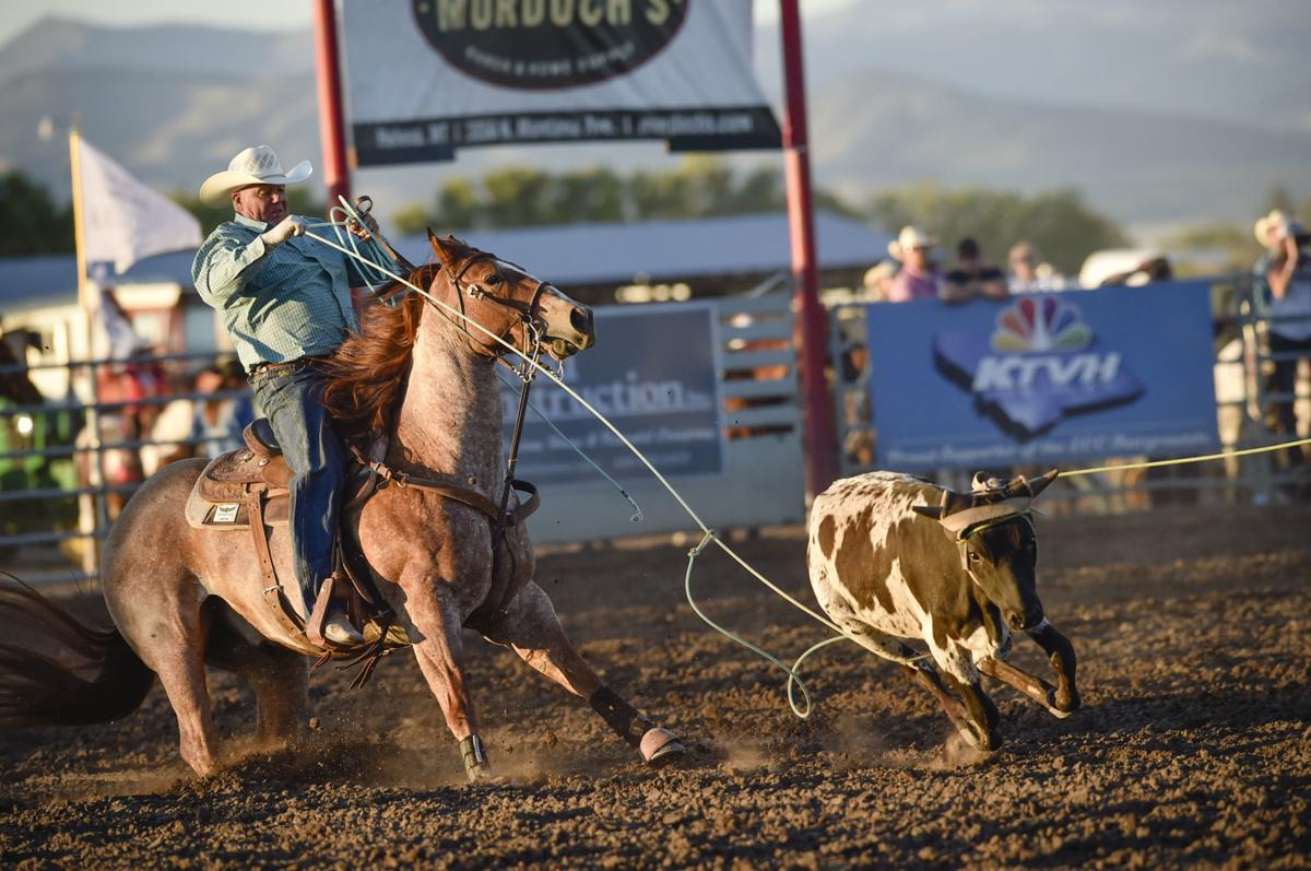 J.R. Winter and Rich Carpenter compete in the team roping